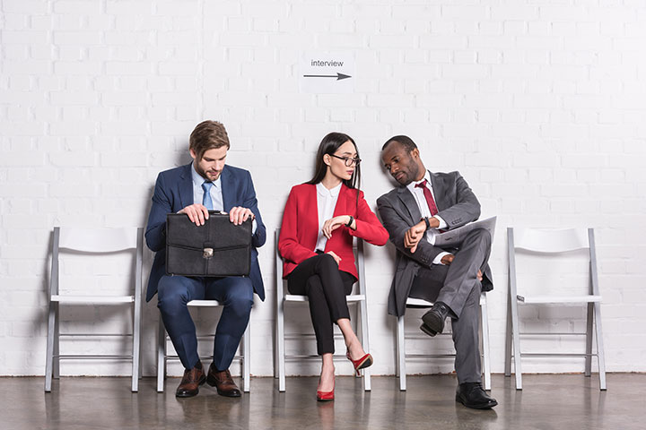 Three job candidates waiting to be interviewed for a job.