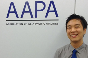 Chuo Sheng Leong standing in front of AAPA sign