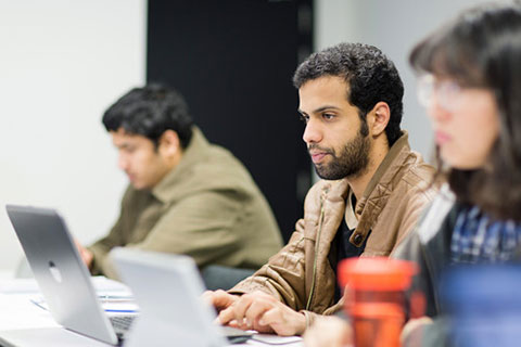Male student using laptop