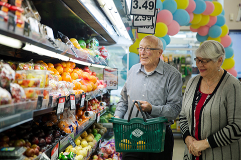 Elderly couple in supermarket