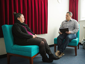 Psychologist talking in office with patient