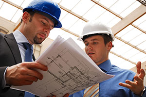 Construction - two men on building site