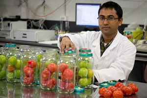 Man in lab with fruit