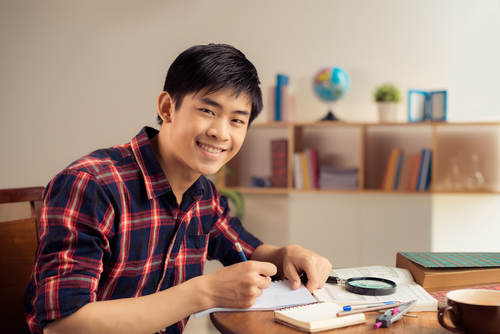Asian male studying