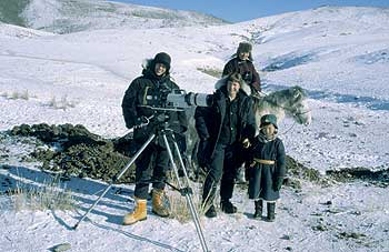 Camera operator Sophie Buck and producer Alison Ballance with herder family, winter, Mongolia. Copyright: NHNZ