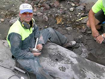 Dr Shane Cronin, director of Massey University's Volcanic Risk Solutions research group, installs a load-cell in bedrock on the 21st of February. The cell is part of a system to measure the density of the lahar.
