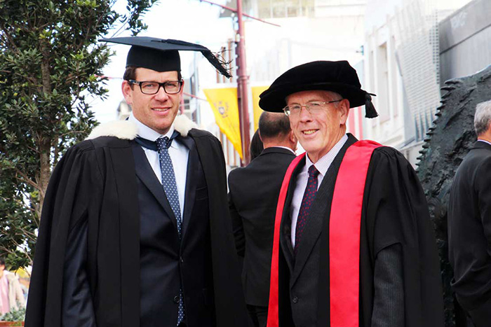 Dr Alec Astle (right) with Jacob Oram