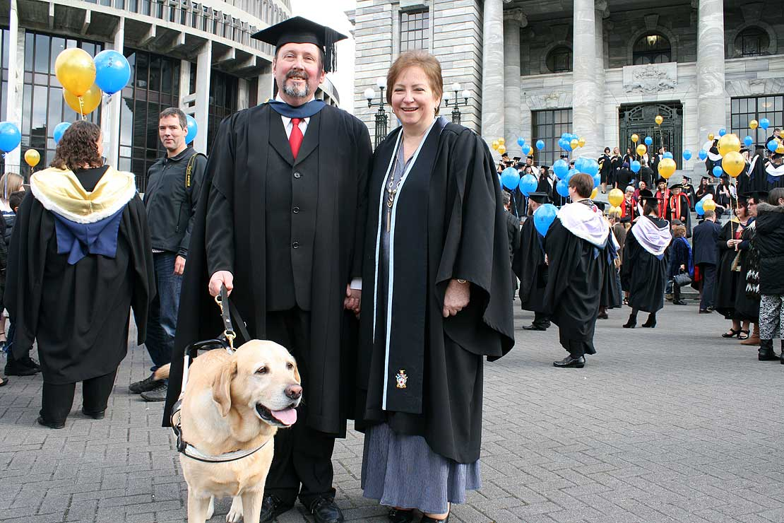Family guide dog part of couple's graduation celebrations